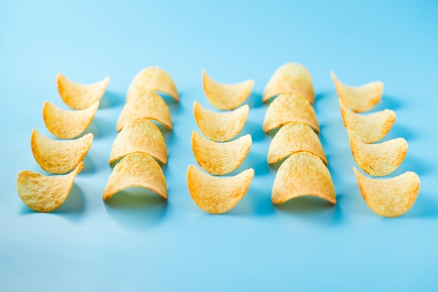 Rows and columns of chips with salt