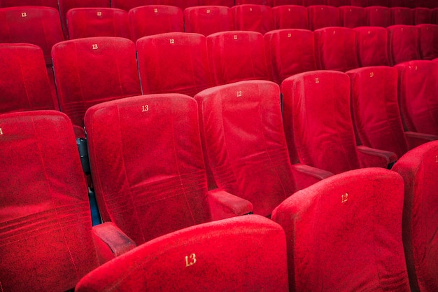 Rows of comfortable red chairs in cinema