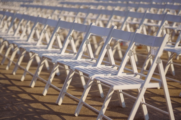 Rows of concert chairs for viewers on the street