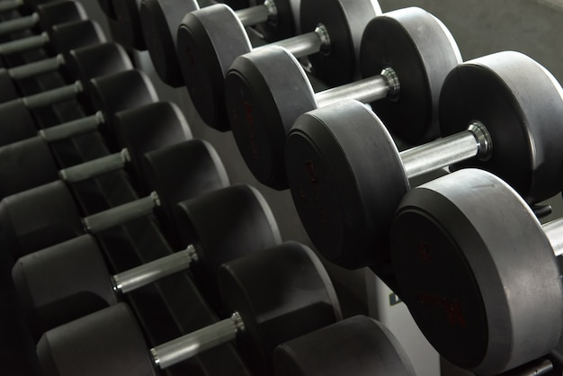 Rows of dumbbell used to exercise in the training gym.