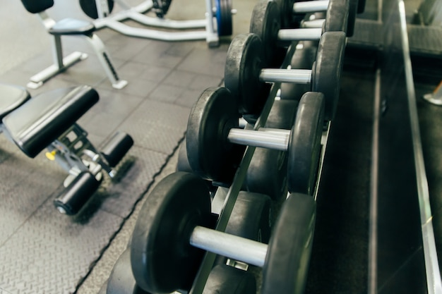Rows of dumbbells in the gym with hign contrast and monochrome c