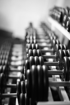 Rows of dumbbells in the gym with hign contrast