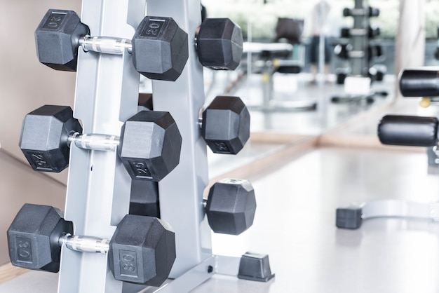 Rows of dumbbells in gym