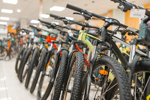 Rows of mountain bicycles in sports shop