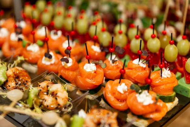 Rows of mouth-watering canapes on the festive table. catering for business meetings, events and celebrations.