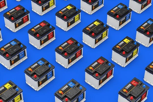 Ряды аккумуляторных батарей 12 в автомобиля с абстрактной этикеткой на синем фоне. 3d рендеринг