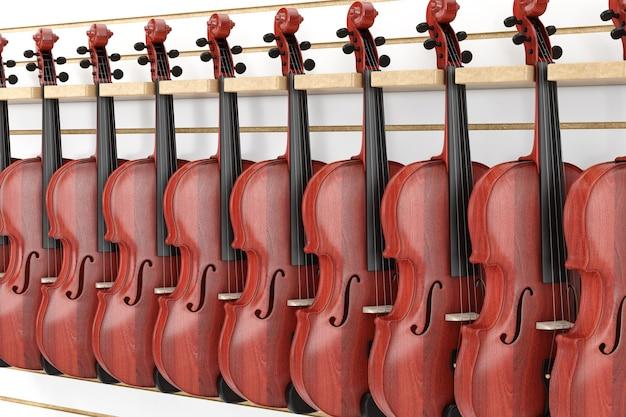 店の極端なクローズアップの棚にぶら下がっている販売のためのヴィンテージの赤い木製バイオリンの列。 3dレンダリング Premium写真