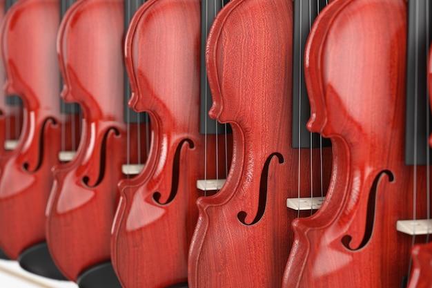 店の極端なクローズアップの棚にぶら下がっている販売のためのヴィンテージの赤い木製バイオリンの列。 3dレンダリング