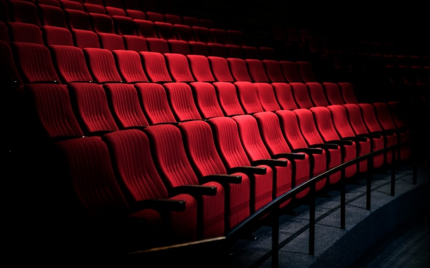 Rows of red seats in a theater