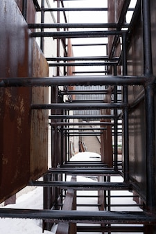 Rows of rusty metal structures