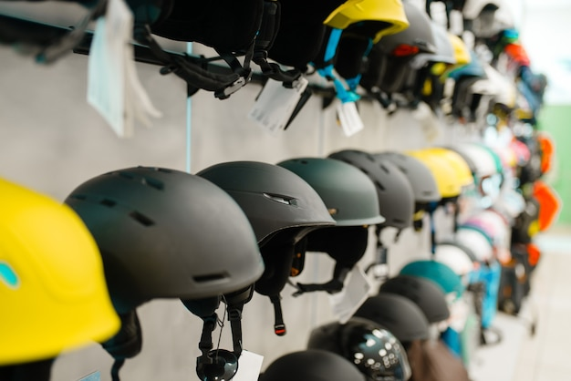Rows of ski and snowboarding helmets, sports shop
