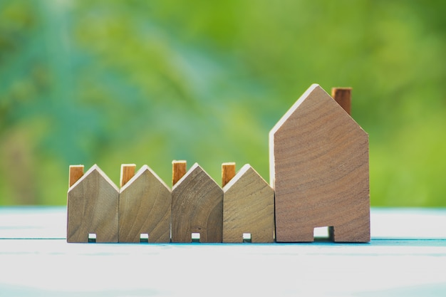 Rows of small wood house on natural green background