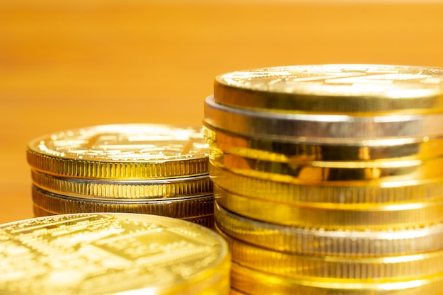Rows, stacks of coins, selective focus of close up view and blank space