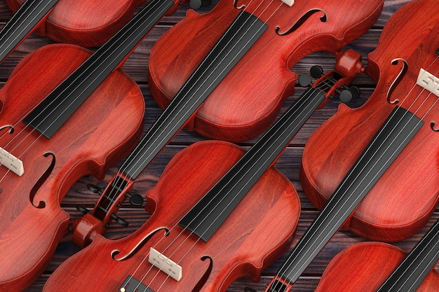 Rows of vintage red wooden violins on a wooden table background. 3d rendering