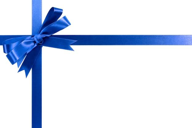 ロイヤルブルーのギフトリボンの弓の横の角の境界線は、白に分離。