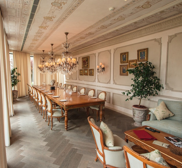 Royal dining room with wooden furniture and chandeliers