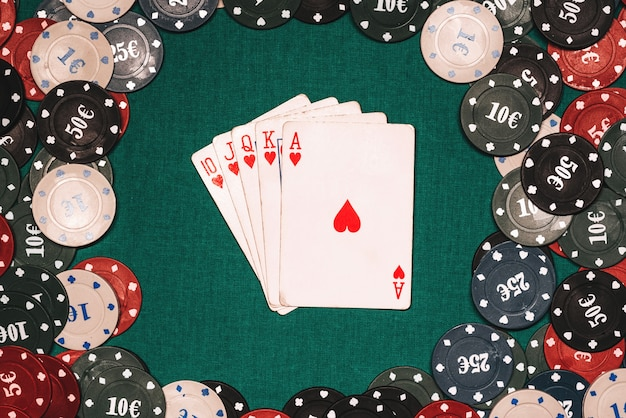 Royal flush on the background of gaming chips