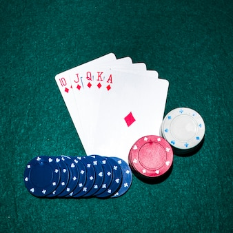 Royal flush playing card and casino chips on poker table