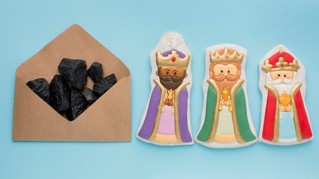 Royalty biscuit edible figurines and coal ore in envelope