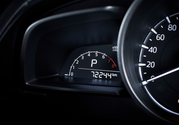 Rpm digital gauge and parking position of automatic transmission and odometer on digital display dashboard in a luxury car