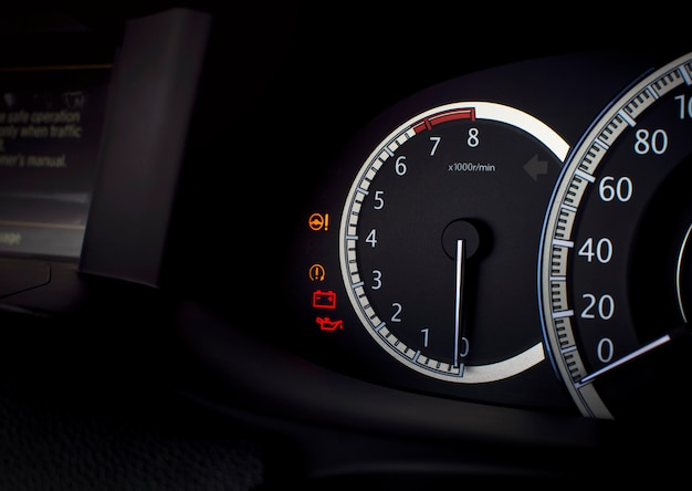 Rpm gauge and warning light such as electric steering,battery,engine oil lubricant on a mileage dashboard in a luxury car,automotive part concept.