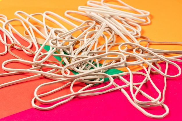 Rrubber bands isolated on colorful background