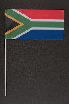Rsa flag on black background. national symbols of republic of south africa. vertical frame