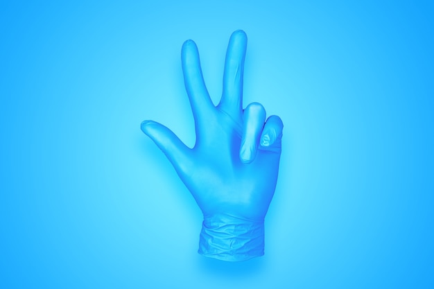 青の背景に分離された 3 つの手のジェスチャーをしているゴム手袋