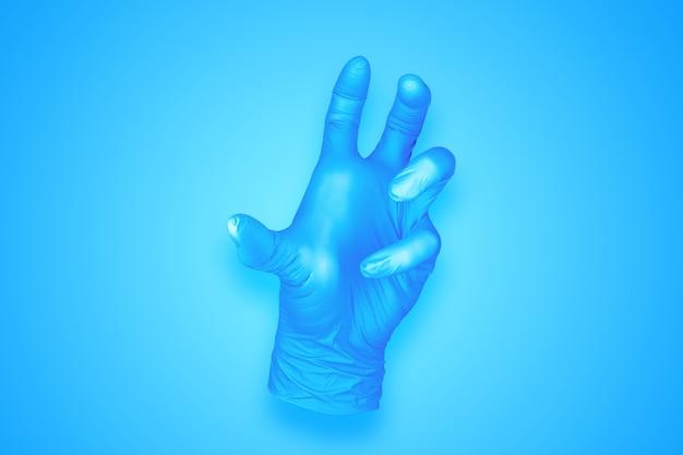 青の背景に分離された何も手のジェスチャーを保持しているゴム手袋
