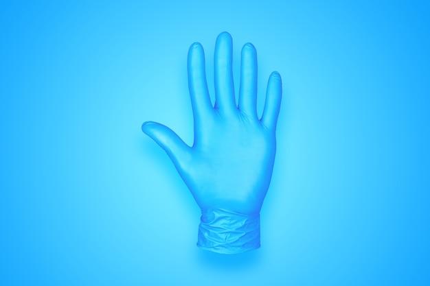 青の背景に分離されたゴム手袋