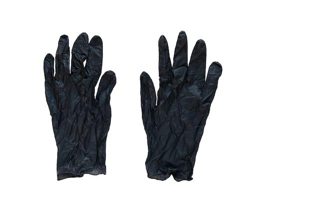 Резиновые перчатки черные одна пара, изолированные на белом фоне, концепция защиты