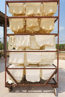 Rubber sheets dry the raw rubber latex is made of acid, which makes it first and then rolled