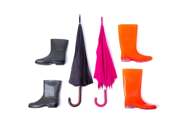 Rubber shoes and umbrella for couple isolated on white background. rain season and weather forecast. nobody