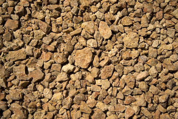 Rubble rock stone construction texture on ground.