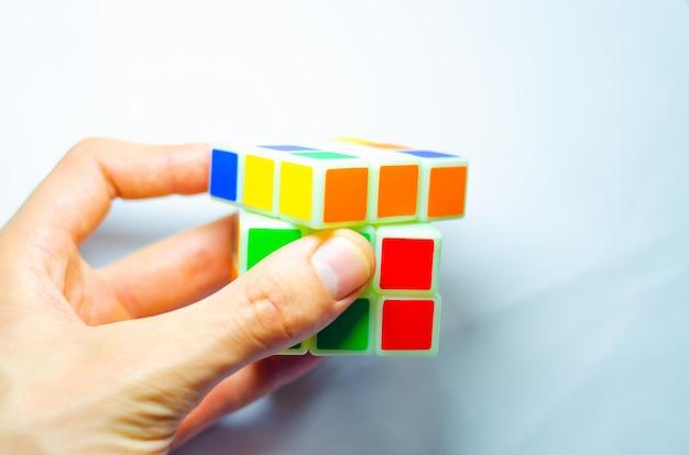 Rubik's cube in hands.