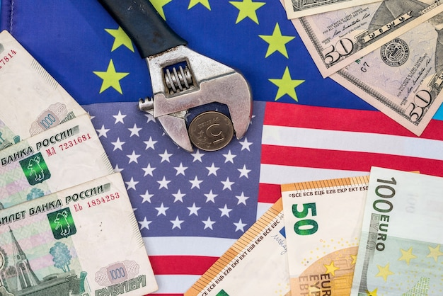 Ruble in vise with money and flag of europe and usa