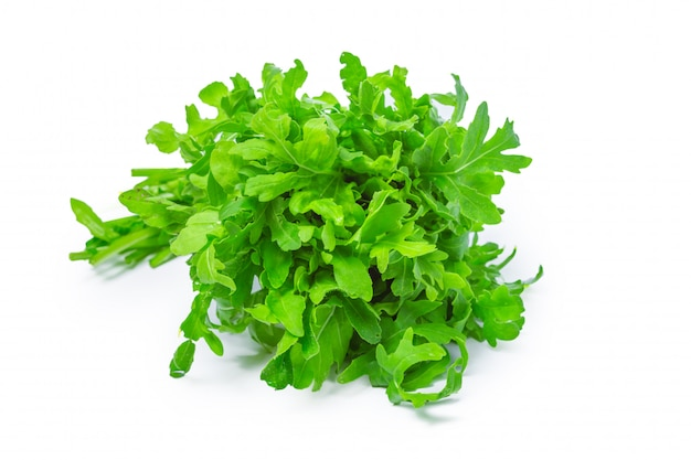 Rucola or arugula, heap, salad leaves, isolated on white background