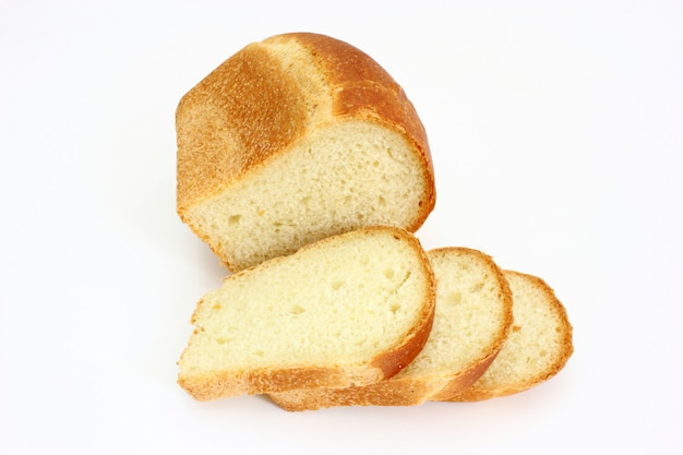 The ruddy long loaf of bread with the fried crust is isolated