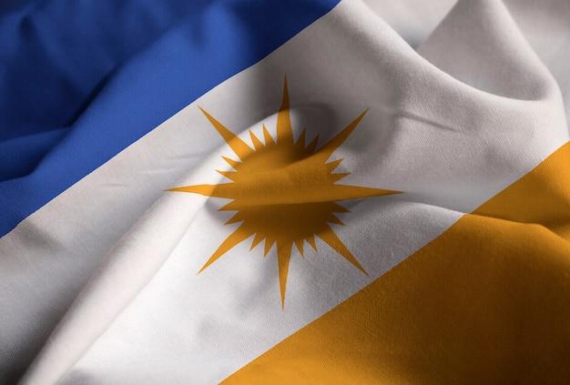Макрофотография ruffled bandeira do tocantins flag, bandeira do tocantins flag blowing in wind