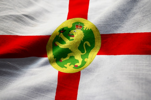 Ruffled flag of alderney blowing in wind