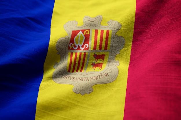 Ruffled flag of andorra blowing in wind