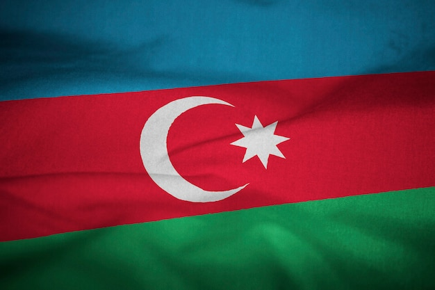 Ruffled flag of azerbaijan blowing in wind