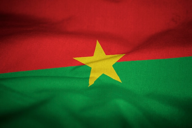 Ruffled flag of burkina faso blowing in wind