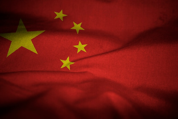 Ruffled flag of china blowing in wind