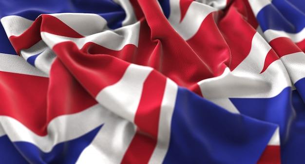 Флаг соединенного королевства ruffled красиво машущий макрос крупным планом выстрел