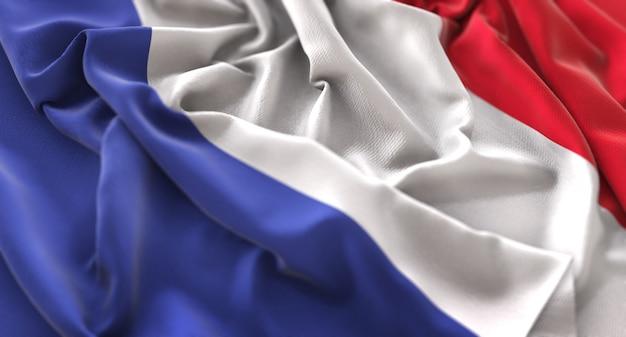 Флаг франции ruffled красиво машет макрос крупным планом выстрел