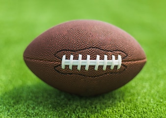 Rugby ball on green turf
