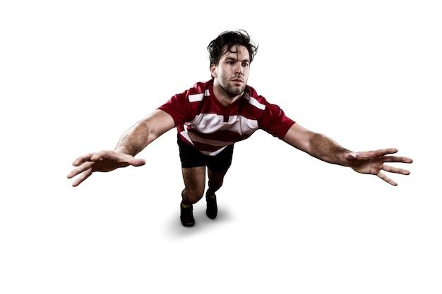 태클을주는 빨간색 유니폼에 럭비 선수.