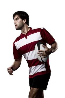 빨간색 유니폼을 입고 럭비 선수.