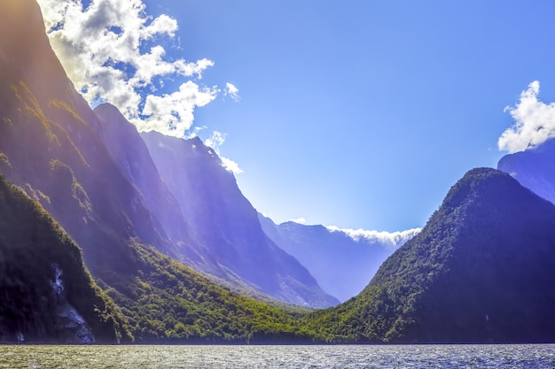 Rugged  peaks of milford sound with sun rays. fiordland, new zealand